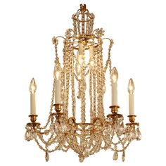 Crystal Art Deco Chandelier | From a unique collection of antique and modern chandeliers and pendants  at https://www.1stdibs.com/furniture/lighting/chandeliers-pendant-lights/