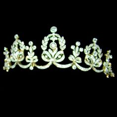 A DIAMOND BELLE EPOQUE GARLAND TIARA  c1890 comprising bows and ribbons surmounted by foliate and stylised fleur-de-lys motifs, all mounted with old brilliant-cut and rose-cut diamonds in platinum millegrain settings on yellow gold back. Detachable from frame and convertible to necklace.
