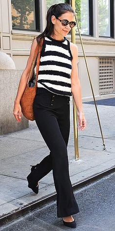 KATIE HOLMES    Another star in stripes! The newly single actress balances trendy high-waist flared pants with a classic black-and-white striped tank and pointy-toe heels.