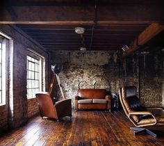 industrial loft goodness with rustic floors and exposed-beam ceiling to die for
