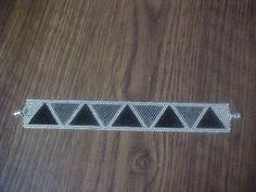 Triangle breaded bracelet in silvers and black.