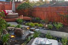 Water Feature Creates Focal Point in Backyard Oasis. Design and install by @pacificridge in #yyj #landscape #landscapedesign