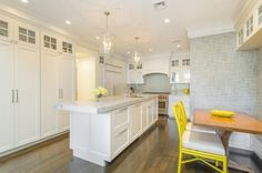 Contemporary Kitchen with Complex granite counters, Flat panel cabinets, Grey Cadenza Textured Wallpaper, Limestone Tile