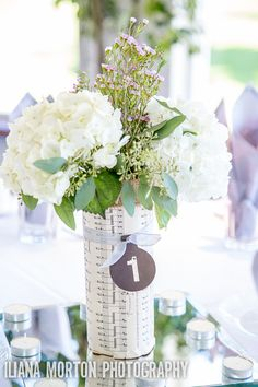 Simple and gorgeous centerpieces that incorporate vintage looking sheet music.