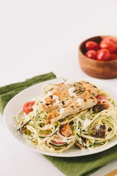 Gluten-Free Caesar Zucchini Noodles with Grilled Lemon Chicken, Tomatoes and Breadcrumbs (use toasted pine nuts instead of breadcrumbs)