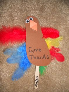 Cute Thanksgiving Day art project for kids.  Trace their foot.  Cut it out and have them glue on feathers and attach to a craft stick.