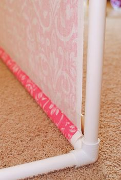 Affordable Photography Backdrops! PVC stand to hold fabric  a piece of molding along the bottom, makes it look like a wall!