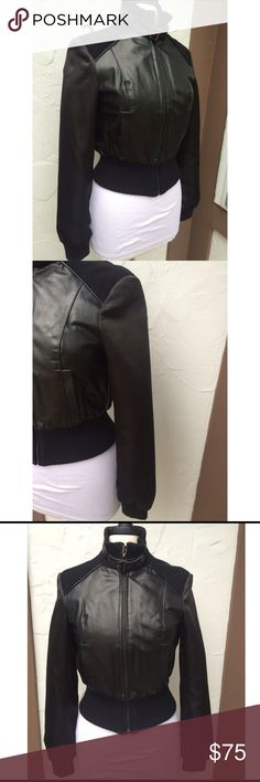 NWOT Bebe Leather Moto Jacket with Satin Sleeve NWOT Bebe Leather Moto Jacket  with Satin Sleeve and Fabric on shoulder and bottom .. 100% Real Leather Size 6 or will fit size 4  80% Wool 20% Nylon bebe Jackets & Coats
