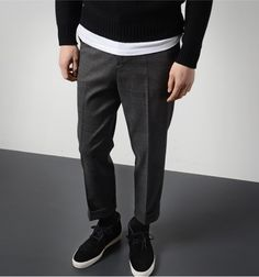 Cropped wool trousers and sneakers.