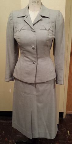 "1940s skirt suit featuring the ""V"" for victory pocket lapel."