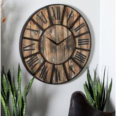 This Oversized Metal Wood Wall Clock has a distressed finish, round-shaped black iron frame with thirteen windows, distressed brown MDF clock face, black roman number markings and clock hands and requires 1 AA battery. Rustic Style, Rustic Decor, Farm House Colors, Wood Clocks, Wooden Walls, Home Decor Outlet, Black And Brown, Decorative Pillows, Gladioli