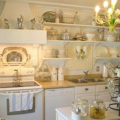 This beautiful kitchen makeover was done on a very strict budget.  Come glean some tips on how to save money for your kitchen makeover! http://www.shabbyfrenchcottage.com