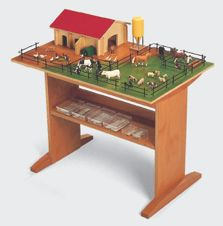 1 - Description du matériel     · Une ferme (étable) disposée sur une plate-forme en bois, avec un pré et des enclos a...