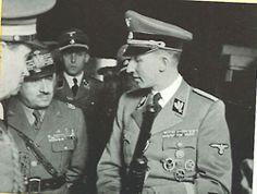 Reinhard Heydrich with a gun and Fascist leaders