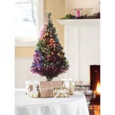 brighten up your home for the holiday season with the holiday time pre lit fiber optic green artificial christmas tree this tree is operated by ul lis - Small Lit Christmas Tree