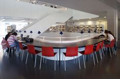 Teresa Pàmies Library, Barcelona, Spain. Cool, modern, crisp. Nice blue color accents provided by table lamps. EA.