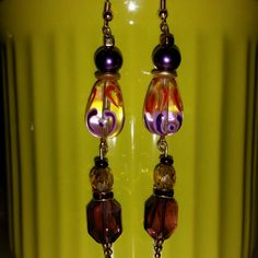 S.crystals purple rectangular dangles This Beautiful pair of earrings, is made of all high quality beads! Brand new Crystal product from Swarovski, the purple Crystals on bottom, pearls, and glass beads. High quality design. Handmade by me =) #greatdeal #hotlook #1ofakind #Supersexy #UwilllookMarv #Classylook #uniqueisgreat #handmadeisthebomb! ! #Oneofakind #onlyuwillhave! ! ! ! ! Mine  Jewelry Earrings