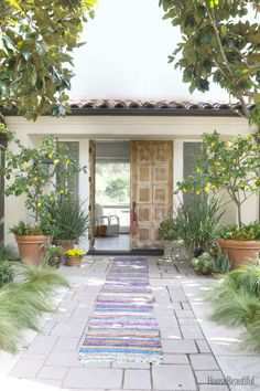 A runner made from vintage saris leads to the entry of the Mediterranean-style 1970s house, on a grassy knoll in the Santa Monica Mountains.