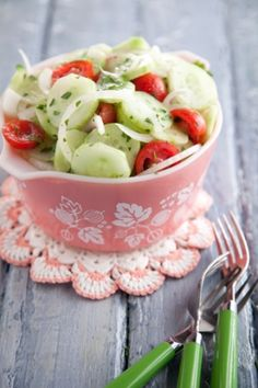 Cucumber, Tomato and Onion Salad _ 1 pound cucumbers (about 2 cucumbers), peeled and thinly sliced   1 pint cherry tomatoes, halved   1/2 Vidalia onion, very thinly sliced   2 tablespoons chopped fresh parsley leaves   1 tablespoon apple cider vinegar   1 tablespoon olive oil   Salt and freshly ground black pepper