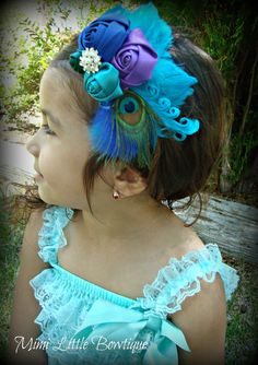 Peacock Inspired Satin  Rolled Flower Embellished with feathers -Baby headband- Newborn headband- Infant headband- Toddler headband. $12.95, via Etsy.