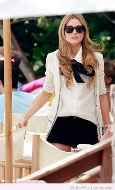 Black bow and white shirt with a lace blazer