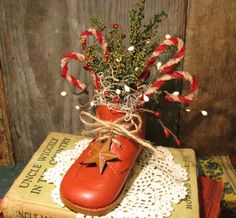 Painted baby shoe....would not be hard to recreate...maybe with a mans boot