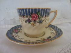"""Royal Doulton Demitasse cup and saucer """"The Vernon"""" pattern,  Fine earthenware product."""