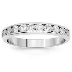 This simple yet elegant womens diamond wedding band is channel set with eleven round cut diamonds which total to 1.45 carats. The frame measures to 1/8 Inches in width and weighs approximately 3.1 grams. Crafted in highly gleaming 14K White Gold, this lovely womens diamond wedding band is an ideal gift at an affordable value. $1,690.00