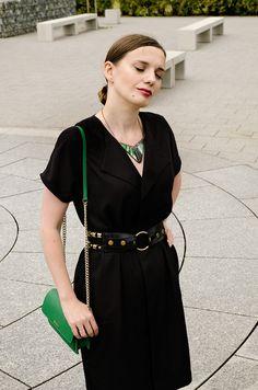 Green necklace, green dkny bag, black dress