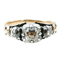 Georgian Old Mine Cut Diamond Ring. Diamonds set in silver on gold.