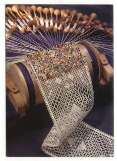 Along with spinning my own yarn, I want to make bobbin lace. Look at this! This is intense! I had three beautiful carved lace bobbins that were stolen when we moved from TX. : (