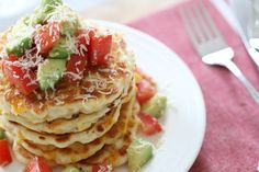 The easiest and tastiest cheesy corn fritters served with a light tomato and avocado salsa. Kid-friendly and totally delicious! Lunch Box Recipes, New Recipes, Cheesy Corn, Corn Fritters, Vegetarian Cheese, Entrees, Healthy Snacks, Avocado, Tasty
