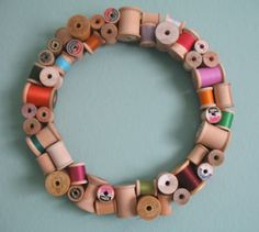 Wooden spool wreath.  Made one for a friend with her mom's wooden spools.
