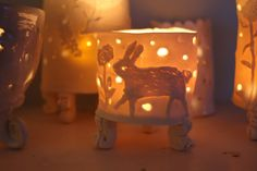 I'm going to make these for my shop in July, porcelain clay tea lights, slab built with little fancy feet and forest animals. Julie Whitmore Pottery: luminous