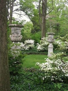 White azalea and Medicis urns in the Bald Cypress Allee at the Marian Coffin Garden at Gibraltar in Wilmington, Delaware