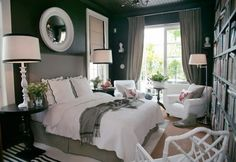 Not a very big bedroom but they used the space beautifully, The white, gray with a splash of pink against the black wall is beautiful.