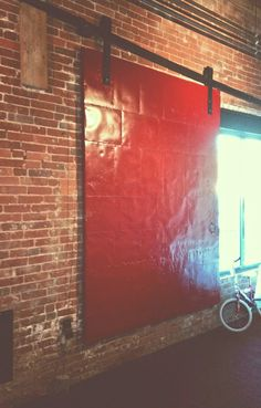 Industrial sliding door to cover huge window at the old redone mill in Millbury Ma
