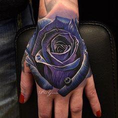 Amazing artist Phil Garcia @philgarcia805 blue rose hand tattoo view 2! #philgarcia #sullen #sullenclothing ...