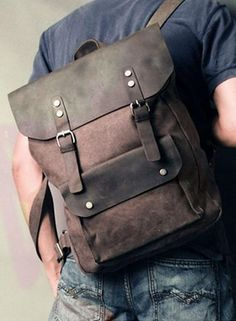 Man wearing the dark brown vintage casual canvas leather student backpack