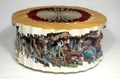 Check out Brian Dettmer's altered book art. I can't imagine how long this carousel took.