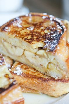 BANANA BREAKFAST SANDWICHES 2 Bananas cut in half lengthwise 4 slices french bread 2 eggs 1/2 cup whole milk 1/2 teaspoon pure vanilla extract 1/2 teaspoon cinnamon pinch salt 1 tablespoon butter maple syrup confectioner's sugar...kid would like these..ah she 26 yrs....