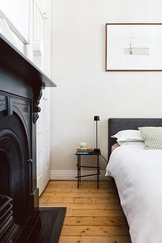 black fireplace in the bedroom