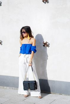 yellow tassel earrings, blue off the shoulder shirt, love cross body bag, white leg trouser pants, summer outfit, spring look, easter outfit