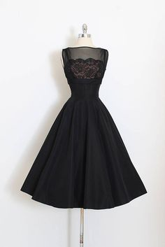 ➳ vintage 1950s dress * gorgeous and pristine * black taffeta * acetate and lace lined bodice * illusion crepe chiffon * bodice stays * metal back zipper condition | excellent fits like xs length 46 bodice 17 bust 34-25 waist 24-25 some clothes may be clipped on dress form to show best fit for appropriate size. ➳ shop http://www.etsy.com/shop/millstreetvintage?ref=si_shop ➳ shop policies http://www.etsy.com/shop/millstreetvintage/policy...