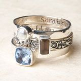 Layer and love this set of three sterling silver rings. Hammered band with pearl; scrollwork band with smoky quartz; smooth band with blue quartz.