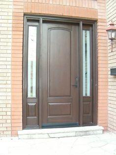 8 ft cherry grain fiberglass door with custom sidelites in light walnut stain.