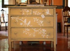 LOVE the birdies painted on this dresser!