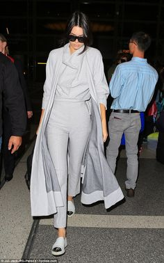 Matchy: Kendall wore grey, steel-toed slip ons and dramatic long coat