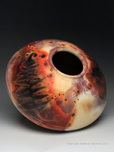 "Charlie & Linda Riggs  |  ""Fossil Pot"".  C Riggs are nationally renowned experts on alternative firing techniques. Most of their work is thrown by Charlie who takes time to make a very smooth surface that will later be polished with terra sigillata. These pots are then finished with one of the smoke fired techniques that results in a shiny unglazed surface brilliant with the colors of saggar firing, the bold blacks and whites of naked raku or the subtle marks of horsehair and ferric chloride."