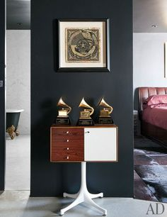 Maroon 5's Grammys find a home on a George Nelson cabinet; the mixed-media work is by Shepard Fairey.
